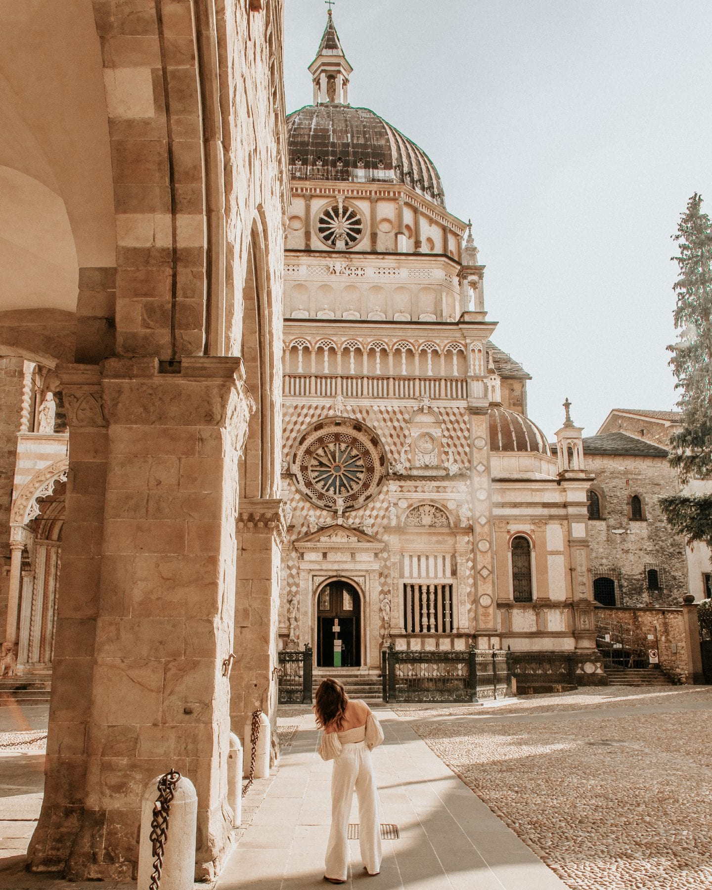 Photo of girl in front of Cappella Colleoni, a very decorated religious monument in Bergamo, Italy