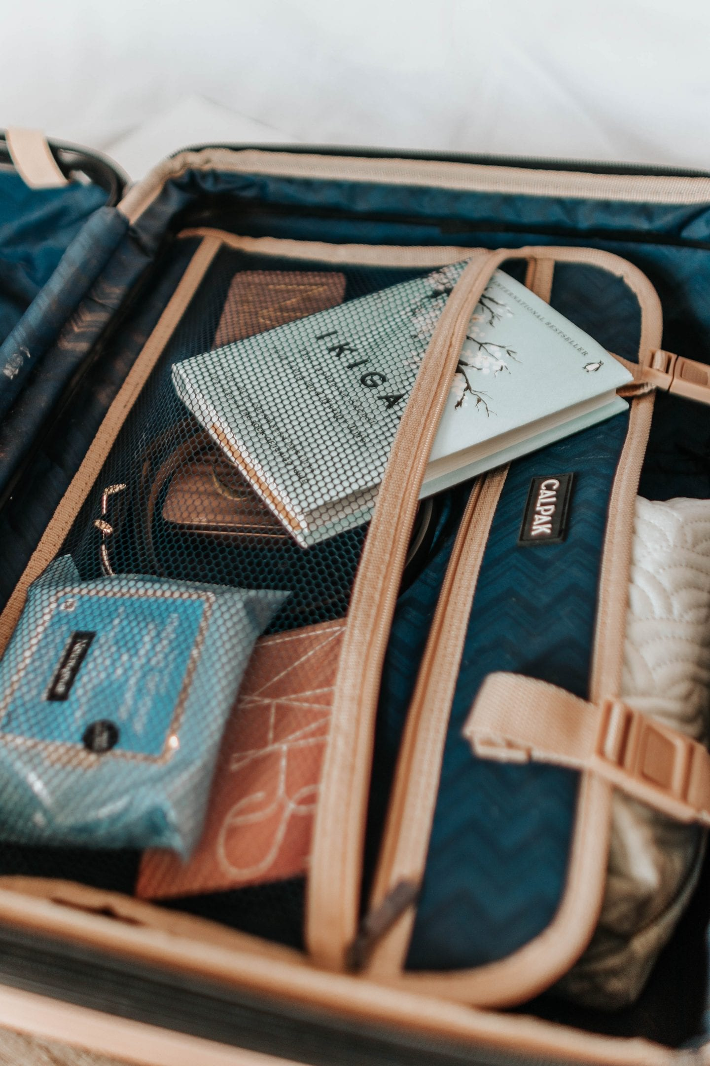 How to Pack a Suitcase to Maximize Space: 11 Organizational Tips So You Can Pack More on Your Next Trip